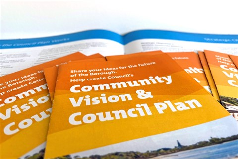Community Vision & Council Plan brochures stacked on top of each other
