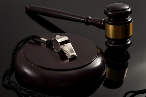 Whistle next to a gavel